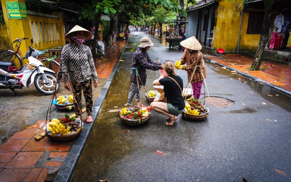 getting fresh fruit in Hoi An